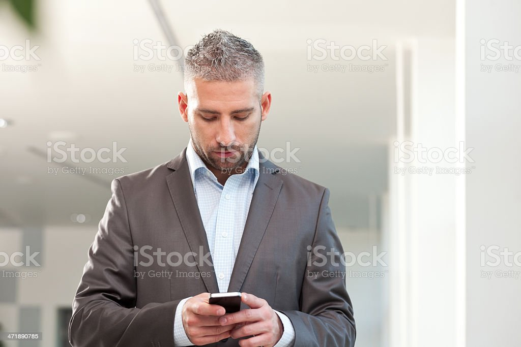 Businessman with smart phone Businessman using a smart phone. 30-39 Years Stock Photo