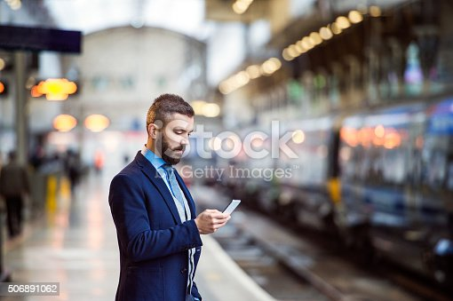 istock Businessman with smart phone 506891062