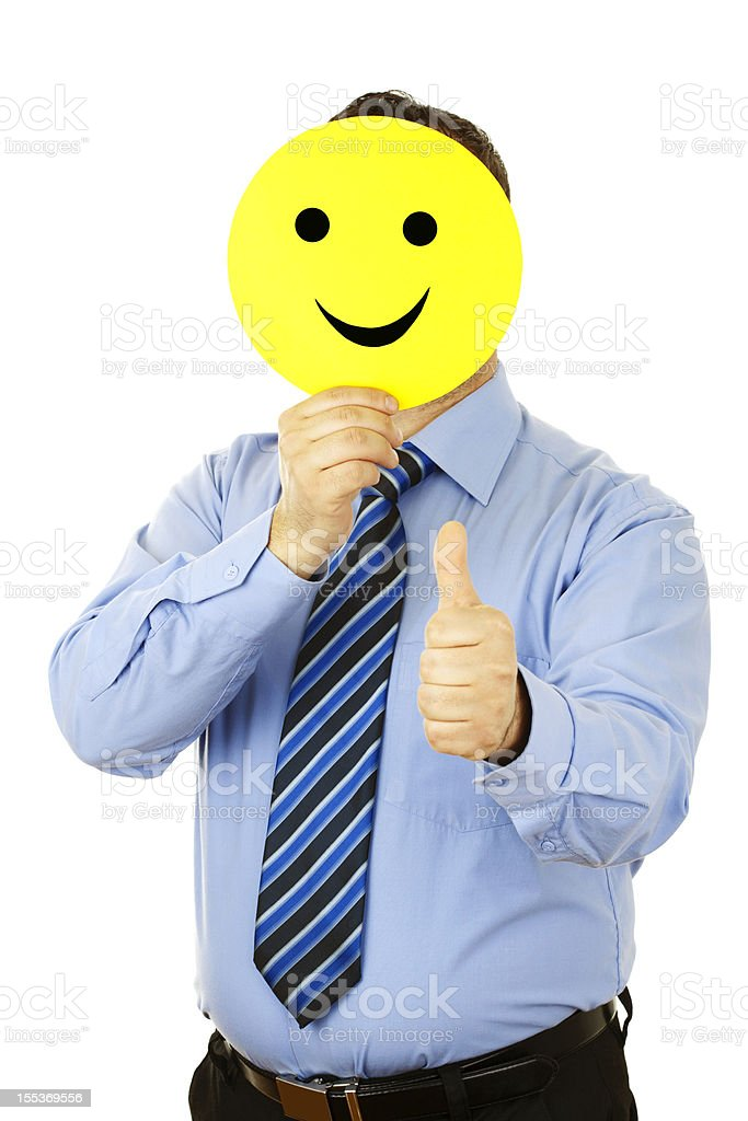 businessman with smile mask stock photo