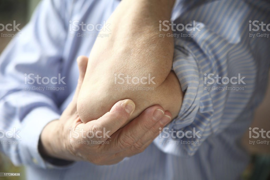 businessman with sore elbow stock photo