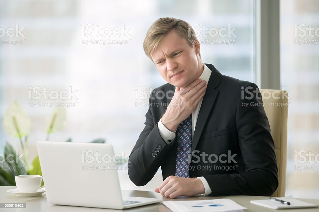 Businessman with sore throat stock photo