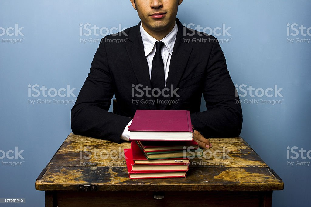 Businessman with stack of books royalty-free stock photo