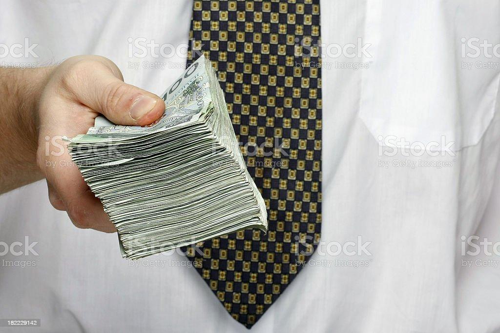 businessman with stack polish money royalty-free stock photo