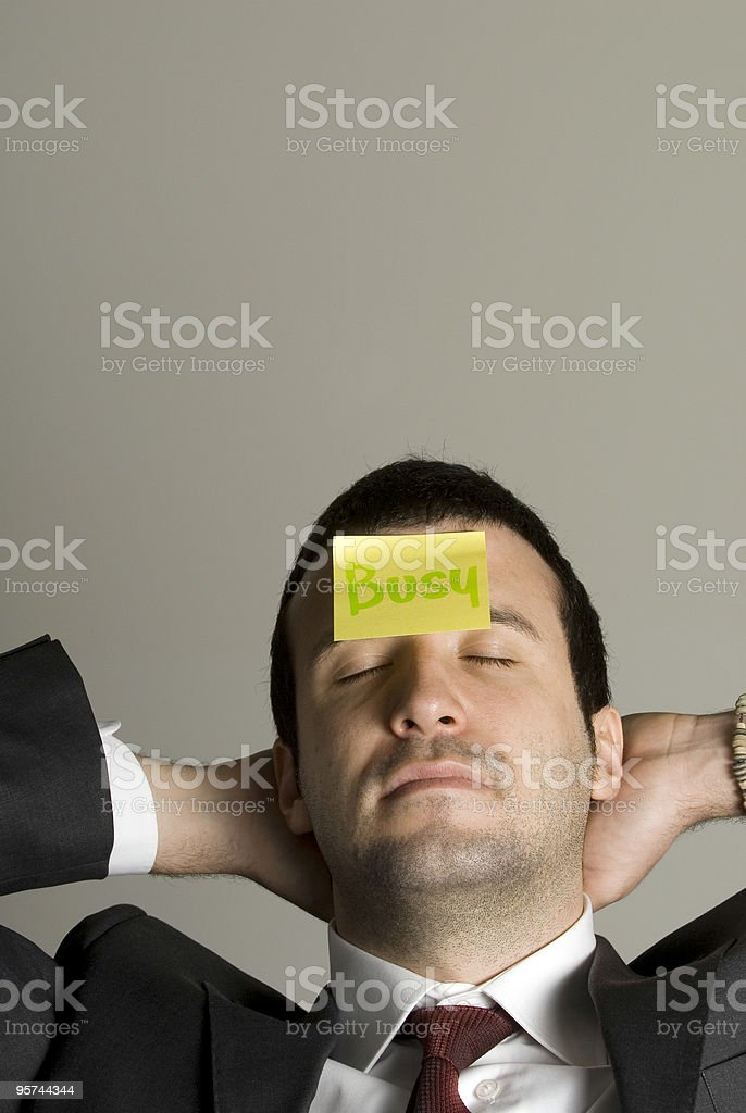 Businessman with sticker on forehead, portrait, busy, Istanbul, Turkey royalty-free stock photo