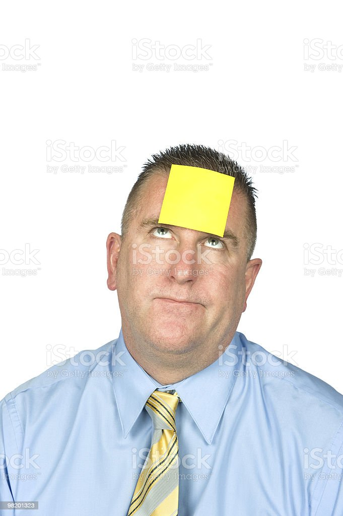 Businessman with sticky note on forehead royalty-free stock photo