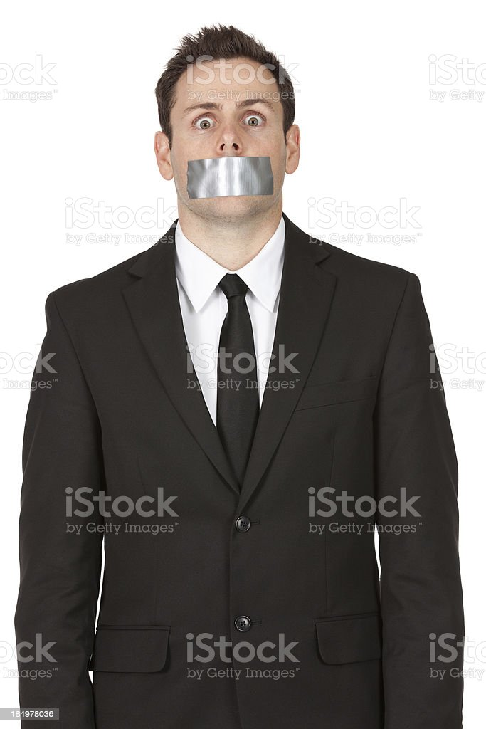 Businessman with sticky tape on his mouth stock photo