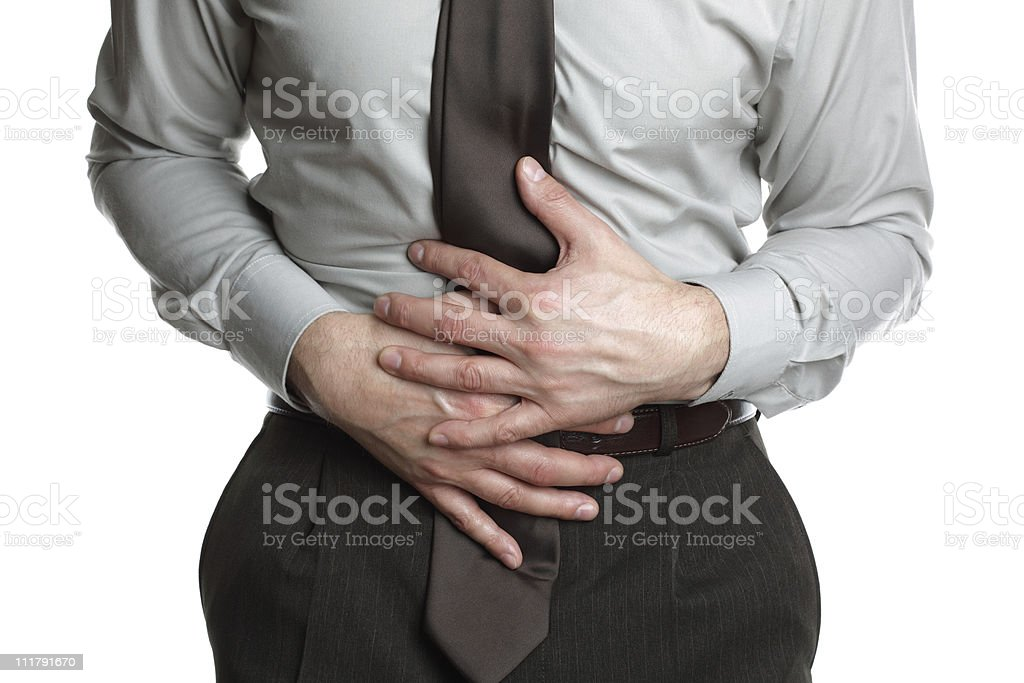 Businessman with stomach ache royalty-free stock photo