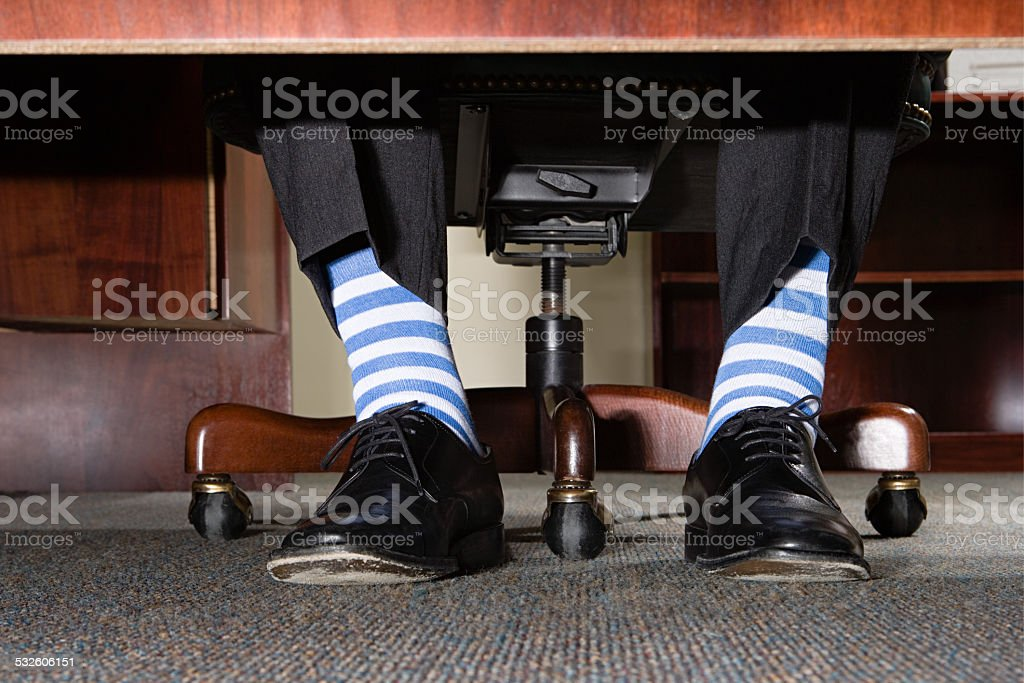 Businessman with striped socks stock photo