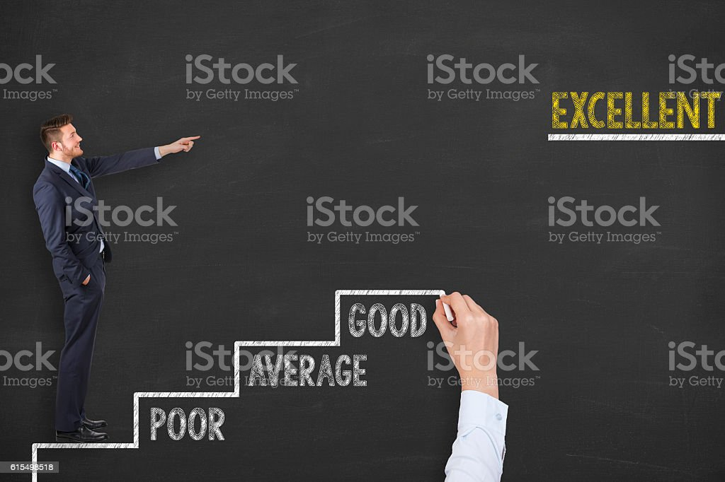 Businessman with suitcase climbing the stairs of excellent stock photo