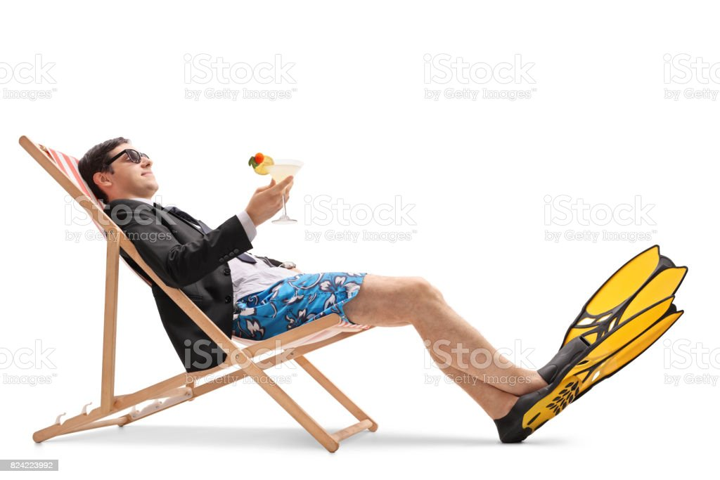 7b9be3e69b Businessman With Swimming Fins Relaxing In A Deck Chair Stock Photo ...
