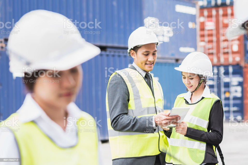 businessman with team in shipping cargo container freight stock photo