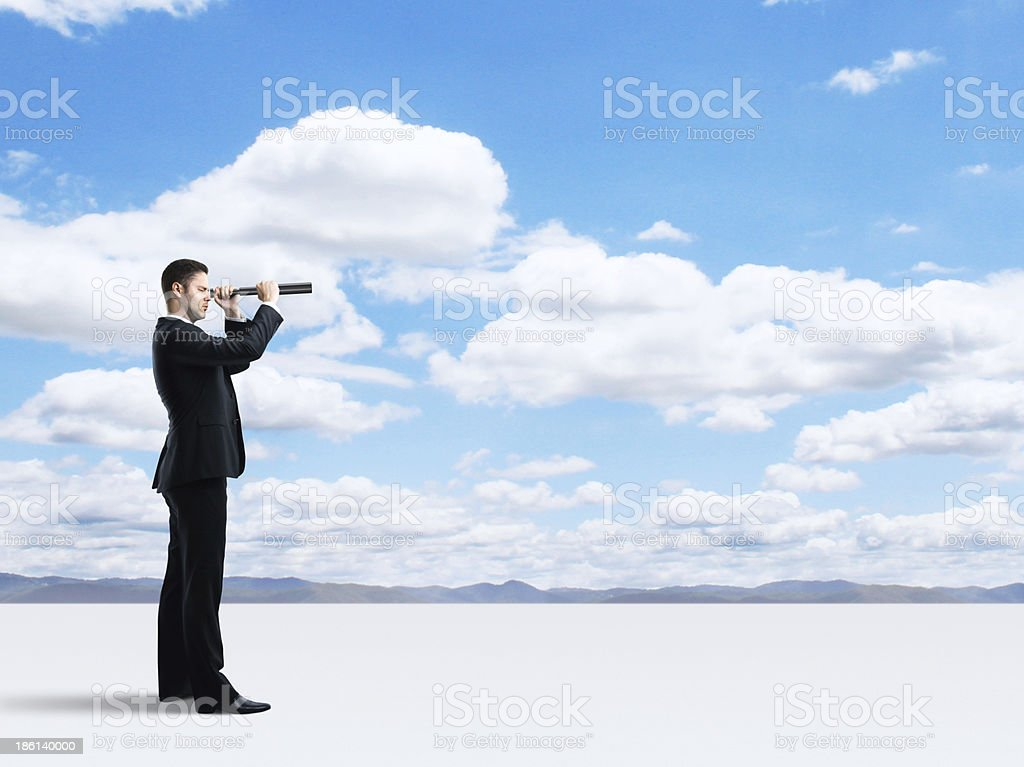 businessman with telescope stock photo