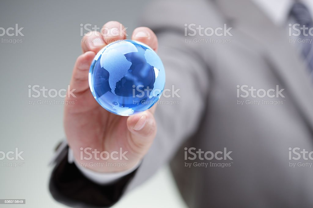 Businessman with the world in his hands stock photo