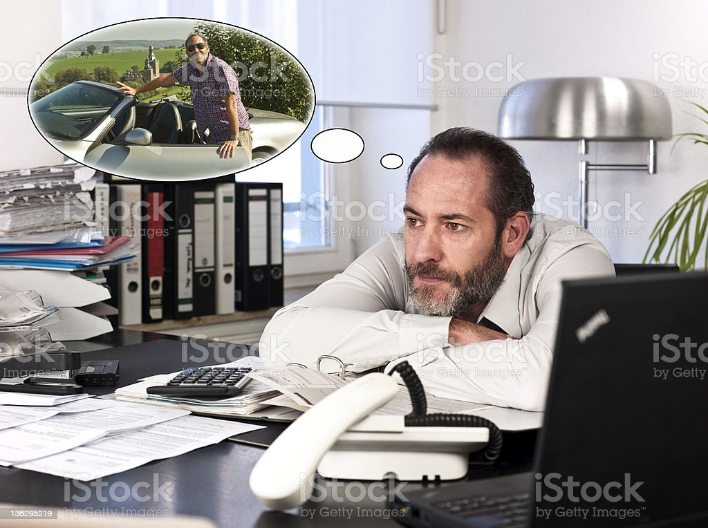 Businessman with thought bubble of the future stock photo