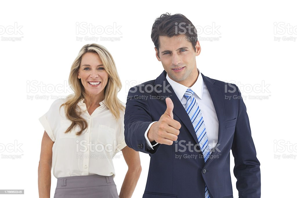 Businessman with thumb up and his smiling coworker royalty-free stock photo