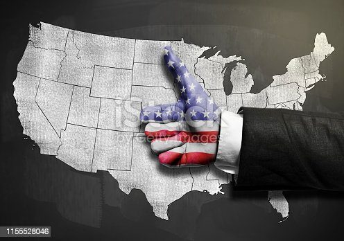 520945644 istock photo Businessman with thumbs map with USA flag over USA map on blackboard / Flag concept (Click for more) 1155528046