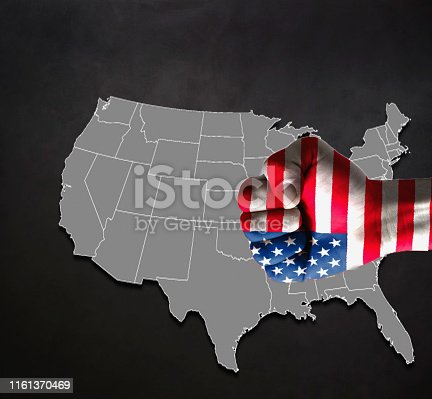 1062171194 istock photo Businessman with thumbs map with USA flag over USA map on blackboard 1161370469