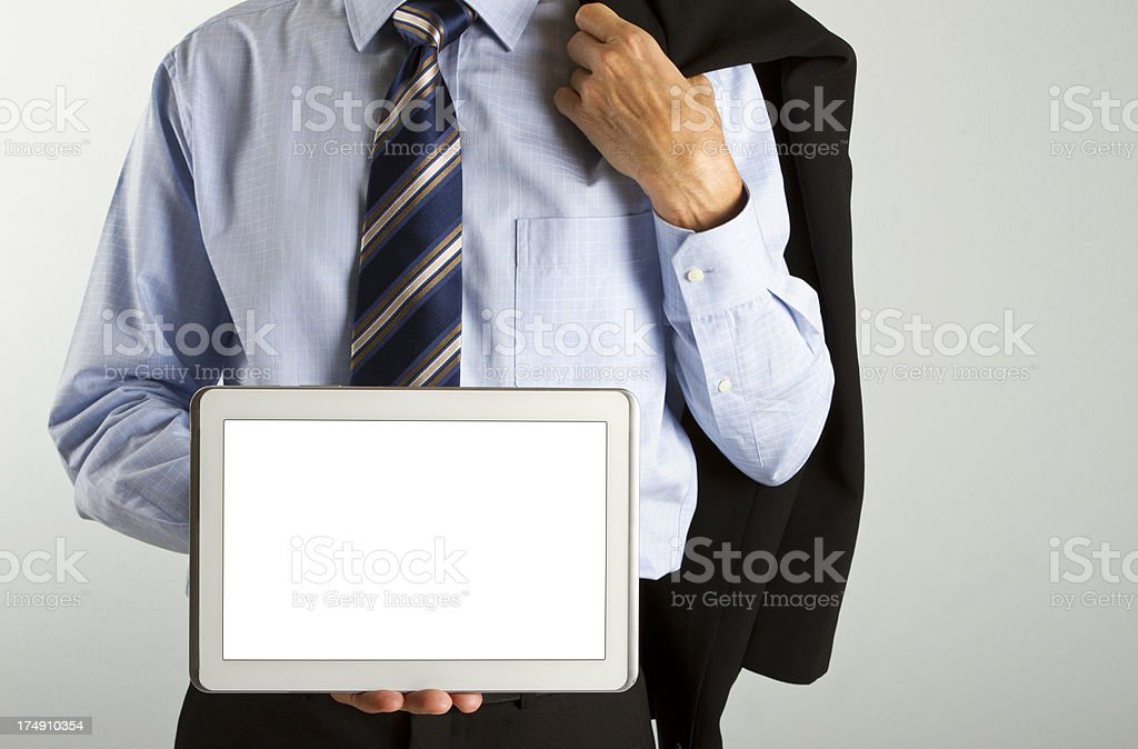Businessman with tie holding a digital tablet royalty-free stock photo