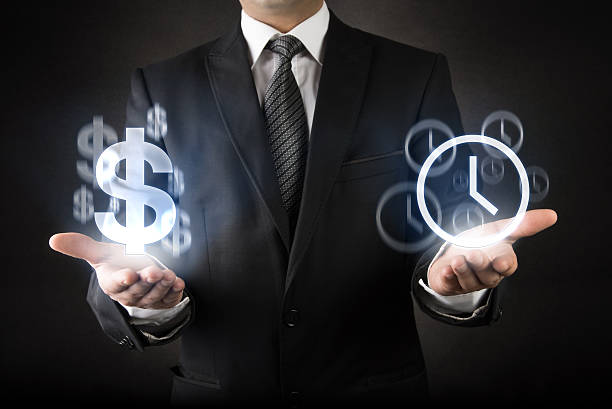 Businessman with Time is Money concept stock photo