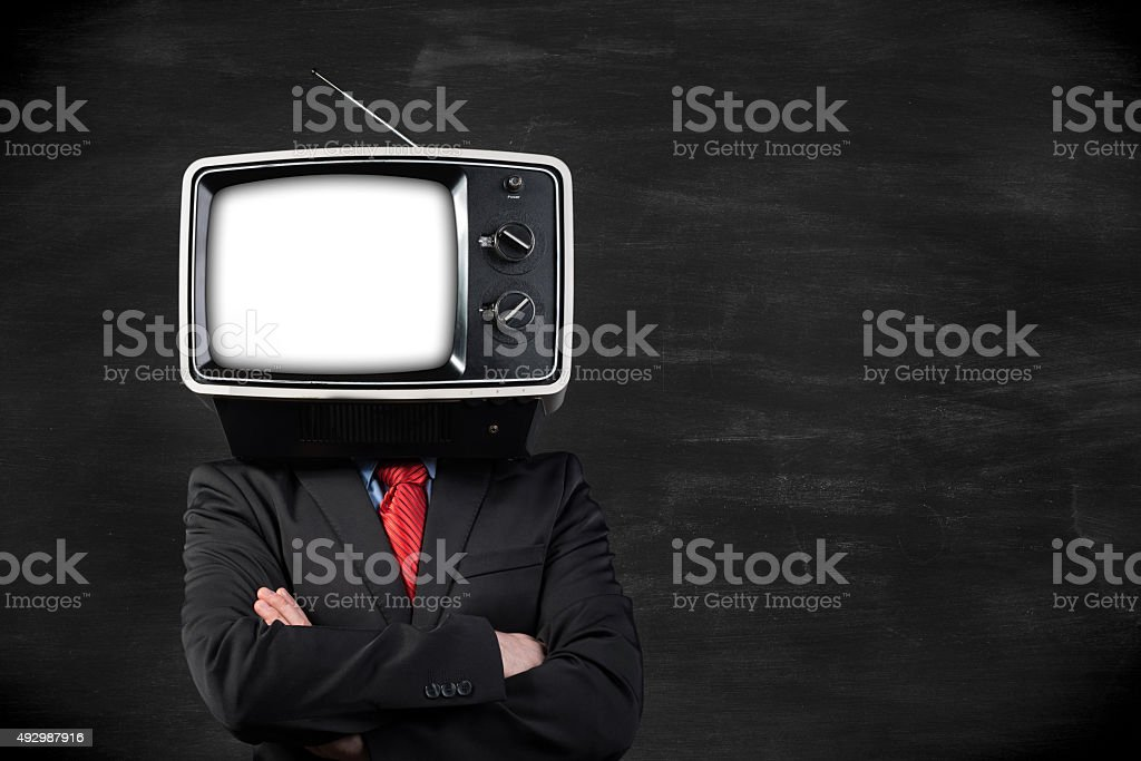 Businessman with TV head in front of blackboard stock photo