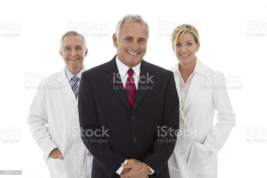 Businessman with two adults wearing lab coat royalty-free stock photo