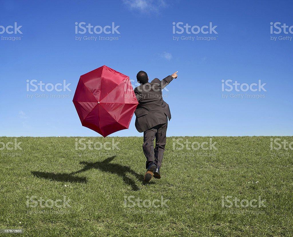 Businessman with umbrella royalty-free stock photo