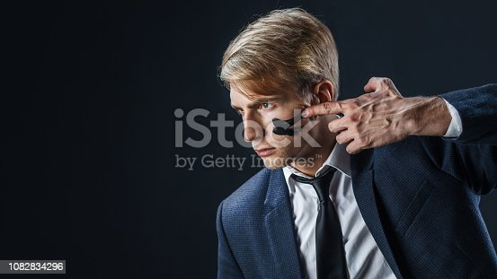 istock Businessman with war paint on his face. Risk management concept. 1082834296