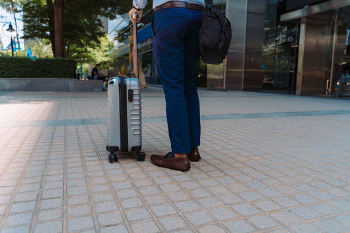 man, businessman, wheeled suitcase, luggage, business travel, journey, arrival, departure, business, on the move