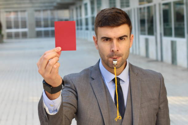 businessman with whistle and red card - judge sports official stock photos and pictures