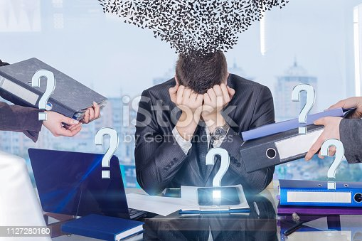 istock A businessman with working stress assault and psychological disorder syndrome. 1127280160