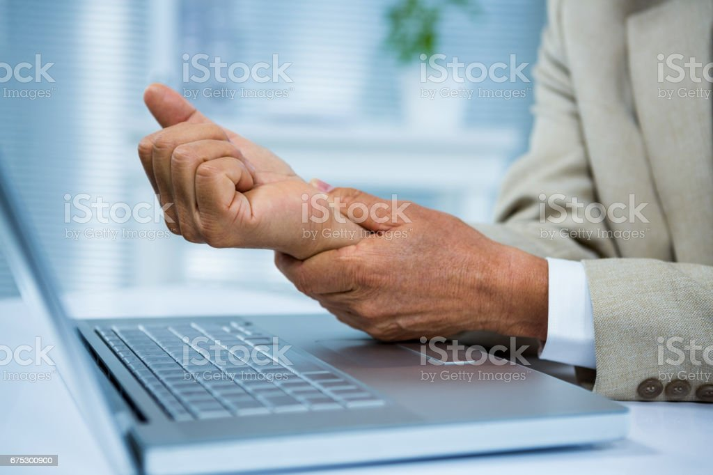 Businessman with wrist pain stock photo