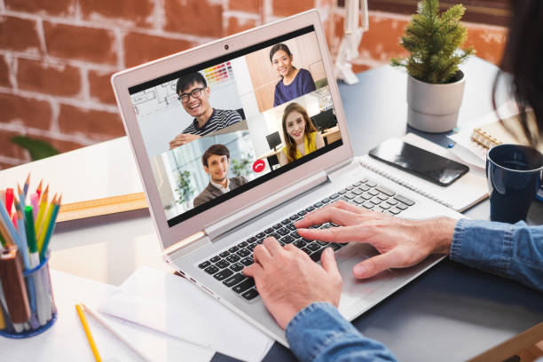 Businessman work at home and virtual video conference with colleagues business people, online working, video call due to social distancing stock photo