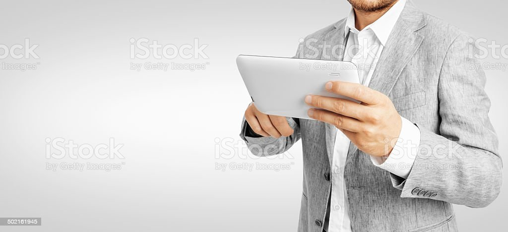 Businessman working a tablet PC -Clipping Path stock photo