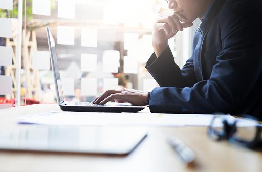Businessman working analysis business information.