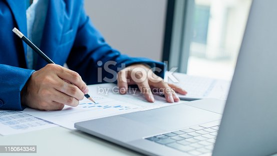 istock Businessman working and analysis on laptop with financial document data graph of business strategy and market growth at workplace. 1150643345