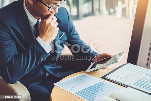 Businessman working and using Digital Tablet new business project finance investment at coffee cafe.