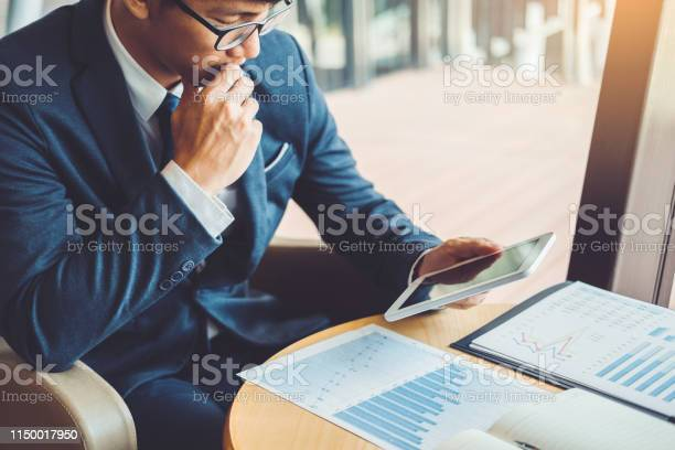 Businessman Working And Using Digital Tablet New Business Project Finance Investment At Coffee Cafe Stock Photo - Download Image Now