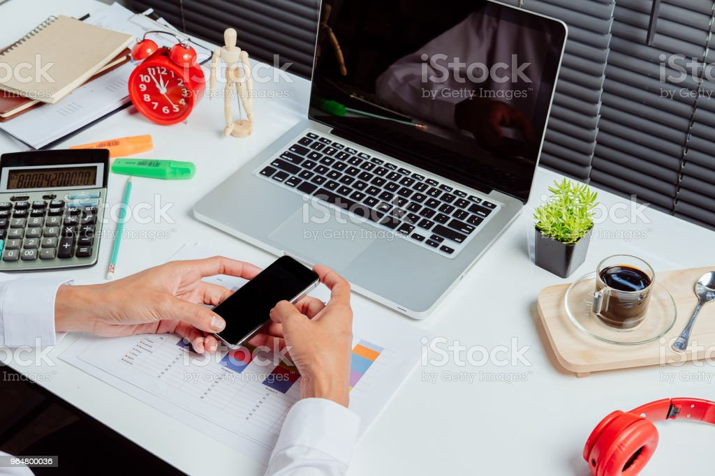 Businessman working and using smart phone royalty-free stock photo