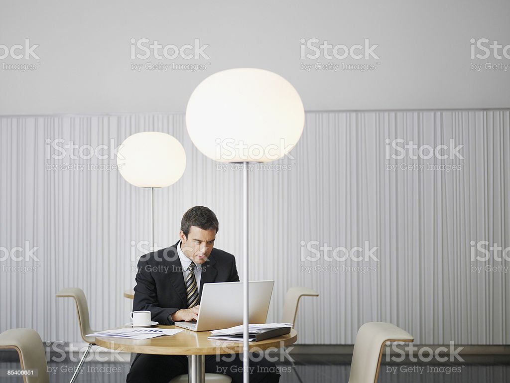 Businessman working at cafe table royalty-free stock photo