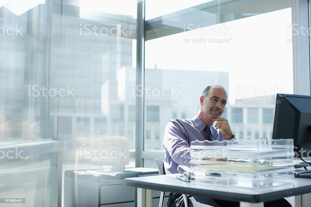 Businessman working at desk stock photo