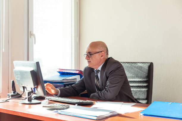 Businessman working at desk Businessman working at desk civil servant stock pictures, royalty-free photos & images