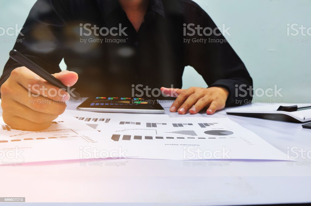 Businessman working at office. Digital tablet laptop computer smart phone royalty-free stock photo