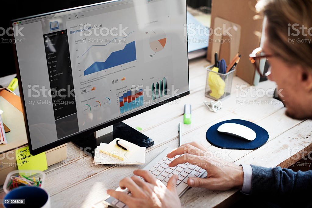 Businessman Working Dashboard Strategy Research Concept ***NOTE TO INSPECTOR: All visible graphics are our own design, and were produced for this particular shoot.*** Adult Stock Photo