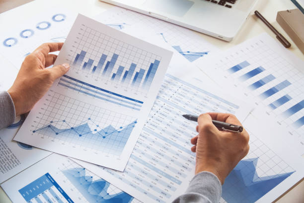 businessman working data document graph chart report marketing research development  planning management strategy analysis financial accounting. business  office concept. - rapporto foto e immagini stock