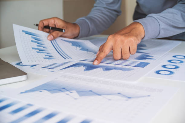 businessman working data document graph chart report marketing research development  planning management strategy analysis financial accounting. Business  office concept. stock photo
