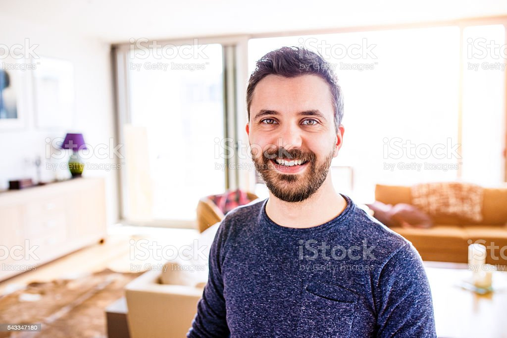 Businessman working from home, taking a break, stock photo