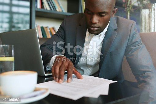 istock Businessman working in a coffee shop 494165982