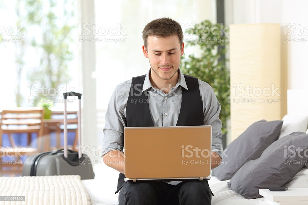 Businessman working in an hotel during a business travel stock photo