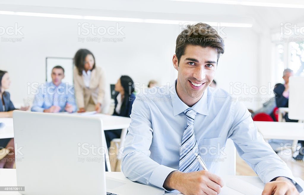 Businessman Working in an Office and Looking at Camera royalty-free stock photo
