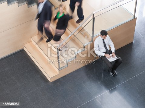 483635979 istock photo Businessman working in busy office corridor 483635981